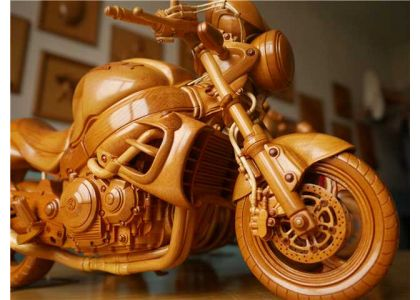 Jilin man turns wood into miniature motorcycles